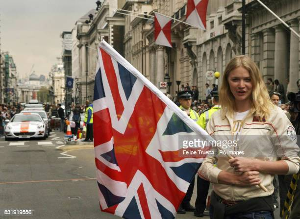 Jodie Kidd waves the start flag of the car rally Gumball 3000 at Pall Mall in London