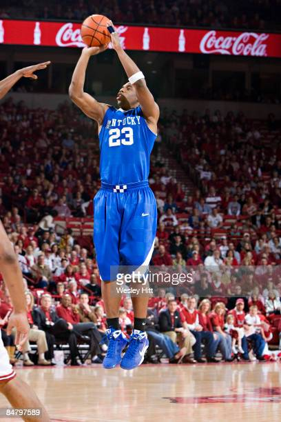 Jodie Meeks of the Kentucky Wildcats shoots a jump shot during their game against the Arkansas Razorbacks at Bud Walton Arena on February 14, 2009 in...