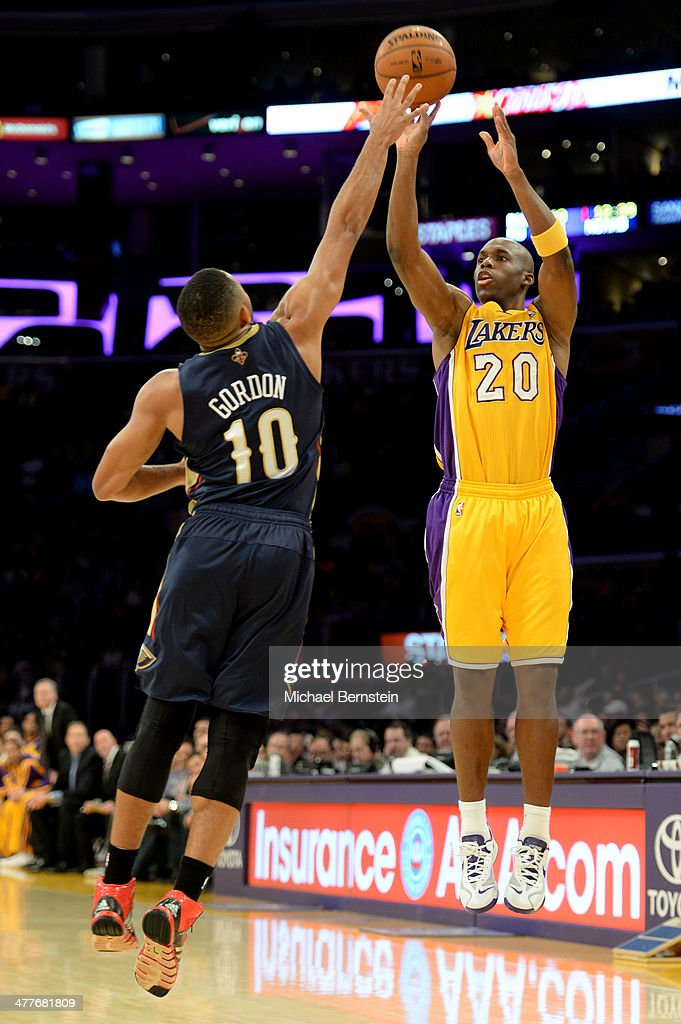Jodie Meeks #20 of the Los Angeles Lakers attempts a shot against the New Orleans Pelicans during a gane at Staples Center on November 12, 2013 in Los Angeles, California.