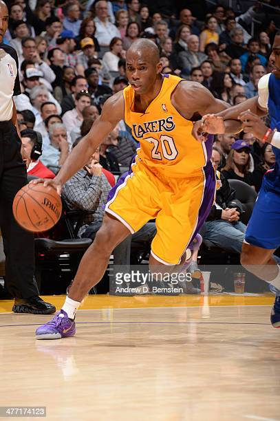Jodie Meeks of the Los Angeles Lakers drives against the Los Angeles Clippers at Staples Center on March 6 2014 in Los Angeles California NOTE TO...