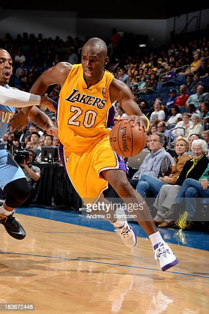Jodie Meeks of the Los Angeles Lakers drives to the basket against the Denver Nuggets at Citizens Business Bank Arena on October 8 2013 in Ontario...