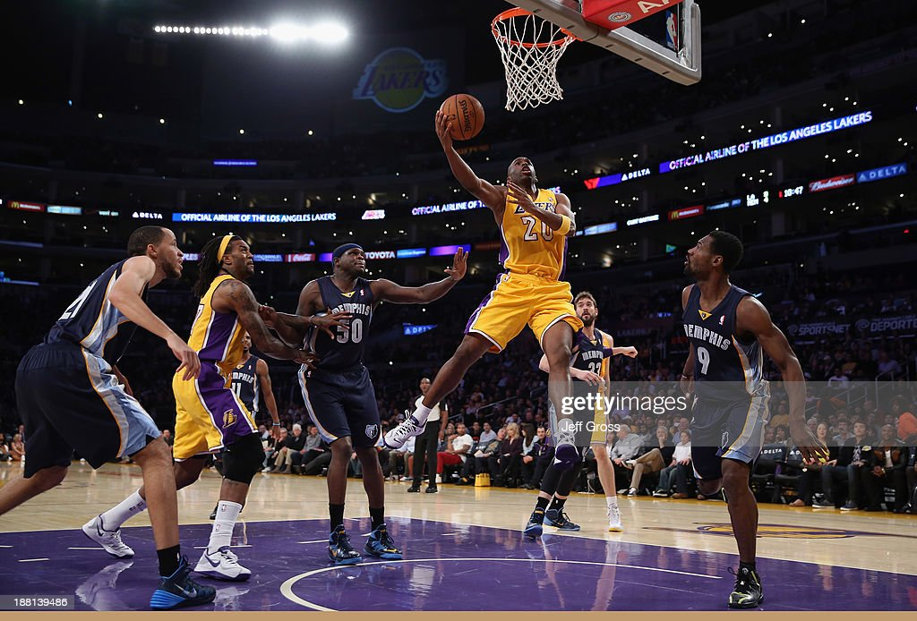 Jodie Meeks #20 of the Los Angeles Lakers drives to the basket for a layup between Zach Randolph (L) #50 and Tony Allen #9 of the Memphis Grizzlies in the first half at Staples Center on November 15, 2013 in Los Angeles, California.