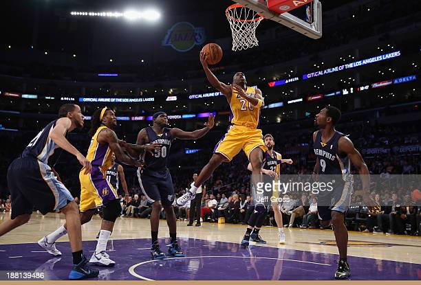 Jodie Meeks of the Los Angeles Lakers drives to the basket for a layup between Zach Randolph and Tony Allen of the Memphis Grizzlies in the first...