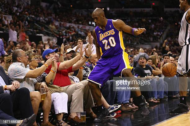 Jodie Meeks of the Los Angeles Lakers falls into the crowd during Game One of the Western Conference Quarterfinals of the 2013 NBA Playoffs at at ATT...