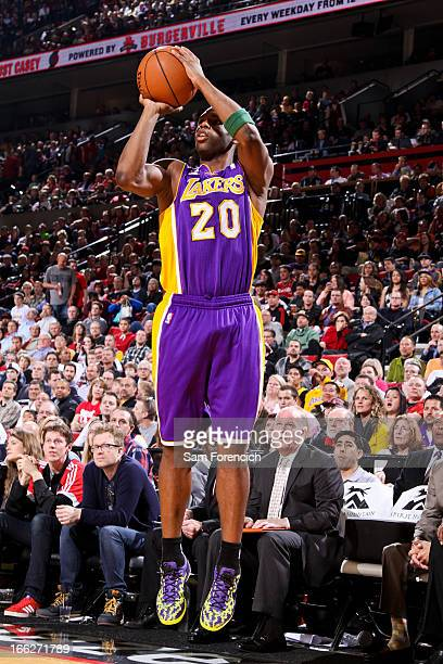 Jodie Meeks of the Los Angeles Lakers shoots a threepointer against the Portland Trail Blazers on April 10 2013 at the Rose Garden Arena in Portland...