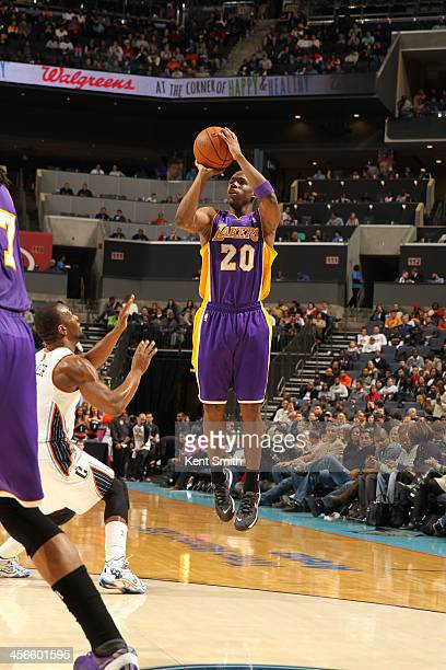 Jodie Meeks of the Los Angeles Lakers shoots against the Charlotte Bobcats during the game at the Time Warner Cable Arena on December 14 2013 in...