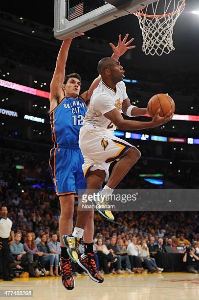Jodie Meeks of the Los Angeles Lakers shoots against the Oklahoma City Thunder at STAPLES Center on March 9 2014 in Los Angeles California NOTE TO...