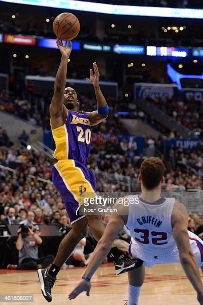 Jodie Meeks of the Los Angeles Lakers shoots during a game against the Los Angeles Clippers at STAPLES Center on January 10 2014 in Los Angeles...