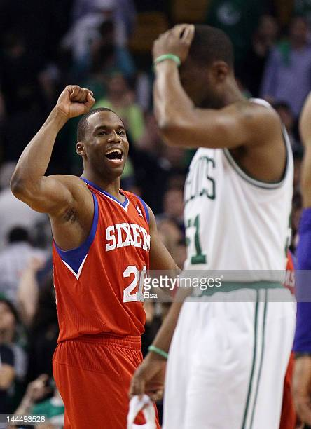 Jodie Meeks of the Philadelphia 76ers celebrates the win as Keyon Dooling of the Boston Celtics walks off the court after Game Two of the Eastern...