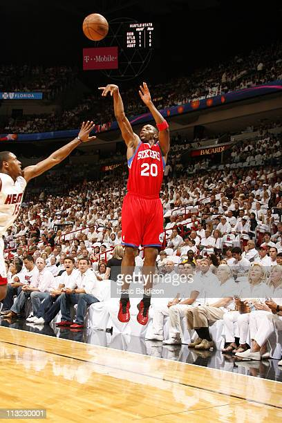 Jodie Meeks of the Philadelphia 76ers shoots against Mario Chalmers of the Miami Heat in Game Five of the Eastern Conference Quarterfinals in the...