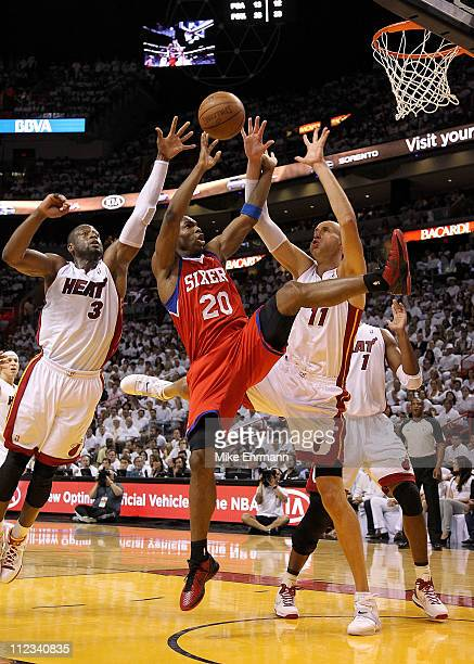 Jodie Meeks of the Philadelphia 76ers shoots over Zydrunas Ilgauskas and Dwyane Wade of the Miami Heat during game two of the Eastern Conference...