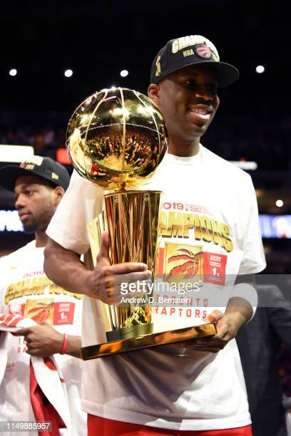 Jodie Meeks of the Toronto Raptors holds up the Larry O'Brien Championship Trophy after Game Six of the NBA Finals against the Golden State Warriors...