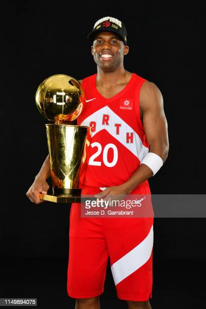 Jodie Meeks of the Toronto Raptors poses for a portrait with the Larry O'Brien Trophy after winning Game Six of the 2019 NBA Finals against the...