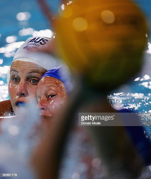 Jodie Stuhmcke of Australia and Valerie Dionne of Canada look for the ball to be dropped in the hole during the 2004 FINA Women's Water Polo League...