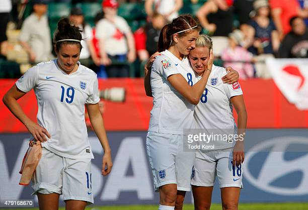 Jodie Taylor, Jill Scott and Toni Duggan of England walk dejected off the pitch after they were defeated by Japan during the FIFA Women's World Cup...