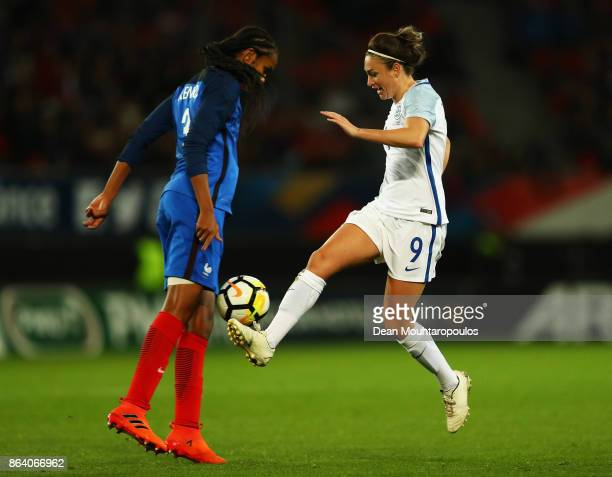 Jodie Taylor of England battles for the ball with Wendie Renard of France during the International friendly match between France and England held at...
