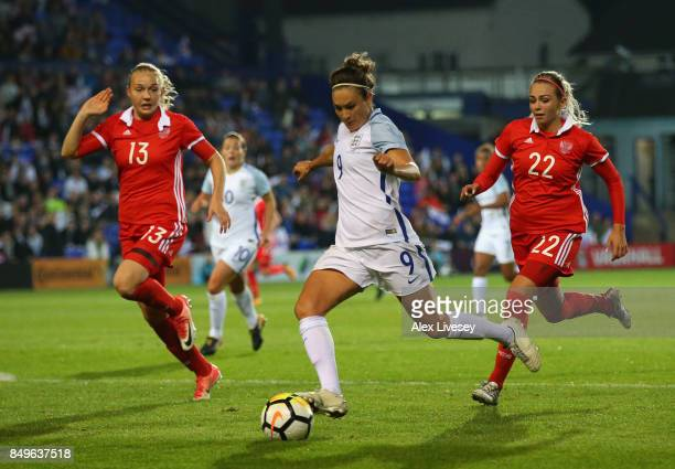 Jodie Taylor of England beats Kseniya Kovalenko of Russia during the FIFA Women's World Cup Qualifier between England and Russia at Prenton Park on...