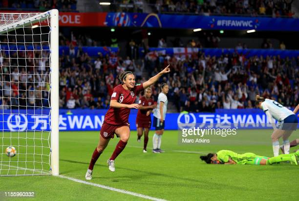 Jodie Taylor of England celebrates after scoring her team's first goal during the 2019 FIFA Women's World Cup France group D match between England...