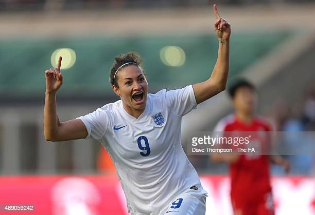 Jodie Taylor of England celebrates scoring the first goal during the Women's International friendly match between England and China at the Manchester...