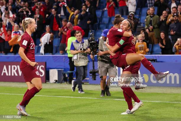 Jodie Taylor of England celebrates with Nikita Parris of England and Beth Mead of England after scoring a goal to make it 10 during the 2019 FIFA...