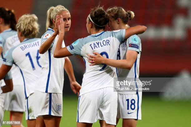 Jodie Taylor of England celebrates with Steph Houghton and Ellen White after scoring her hatrick and the teams fourth goal during the UEFA Women's...