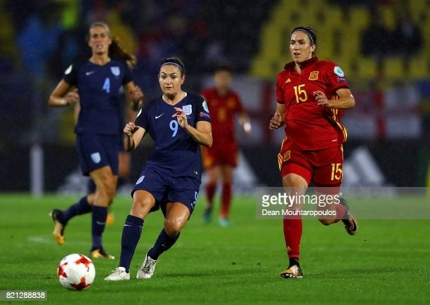 Jodie Taylor of England passes under pressure from Silvia Meseguer of Spain during the UEFA Women's Euro 2017 Group D match between England and Spain...