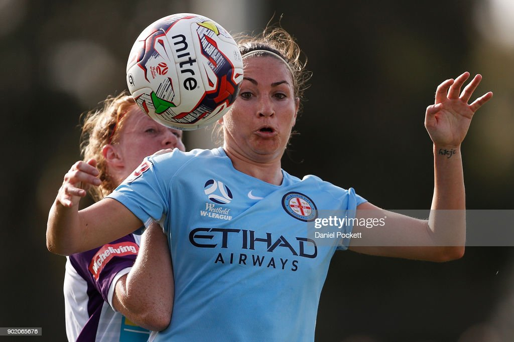 Jodie Taylor of Melbourne City and Shannon May of Perth Glory contest the ball during the round ten W-League match between Melbourne City and Perth Glory at City Football Academy, Bundoora on January 7, 2018 in Melbourne, Australia.