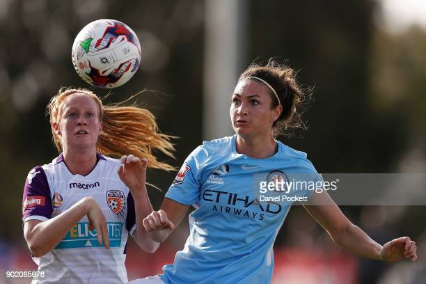 Jodie Taylor of Melbourne City and Shannon May of Perth Glory contest the ball during the round ten WLeague match between Melbourne City and Perth...