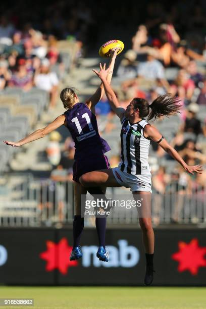 Jodie White of the Dockers and Eliza Hynes of the Magpies contest the ruck during the round two AFLW match between the Fremantle Dockers and the...