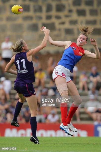 Jodie White of the Dockers contests a ruck with Erin Hoare of the Demons during the round three AFLW match between the Fremantle Dockers and the...