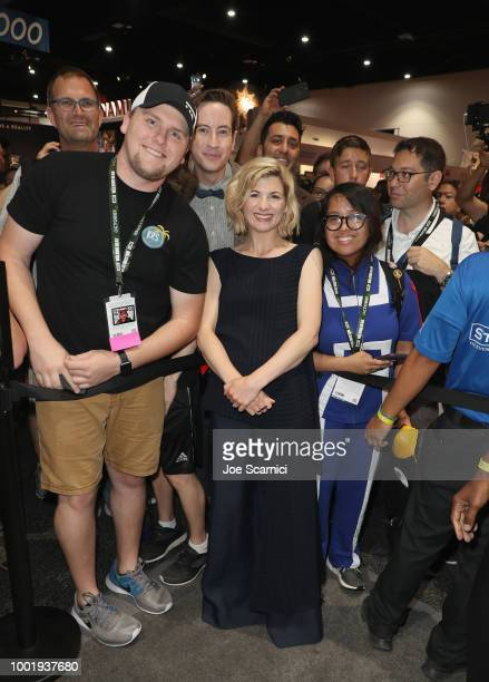 """Jodie Whittaker poses with fans at BBC America's """"Doctor Who"""" at Comic-Con International 2018 at San Diego Convention Center on July 19, 2018 in San..."""
