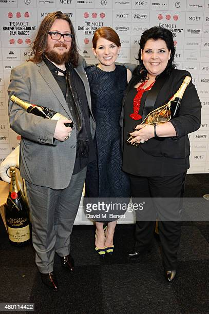 """Jodie Whittaker poses with Iain Forsyth and Jane Pollard, winners of the Douglas Hickox award for """"20,000 Days On Earth"""", at The Moet British..."""