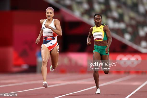 Jodie Williams of Team Great Britain and Roneisha McGregor of Team Jamaica compete in the Women's 400m Semi Final on day twelve of the Tokyo 2020...