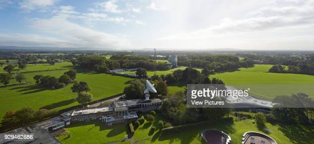 Jodrell Bank Visitor and Exhibition Centre, Macclesfield, United Kingdom. Architect: Feilden Clegg Bradley Studios LLP, 2011. Aerial panorama of site.