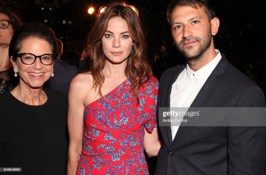 Jody Arnhold, Michelle Monaghan and Paul Arnhold attend the Carolina Herrera show at The Museum of Modern Art on September 11, 2017 in New York City.