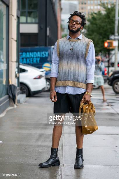 Jody Bainis seen wearing tops by Anderson Bel, Uniqlo JW Anderson, pants by Issey Miyake and shoes by Humant while departing the Bevza Spring Summer...
