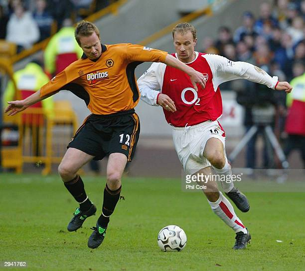 Jody Craddock of Wolves is challenged by Dennis Bergkamp of Arsenal scores the opening goal during the FA Barclaycard Premiership match between...