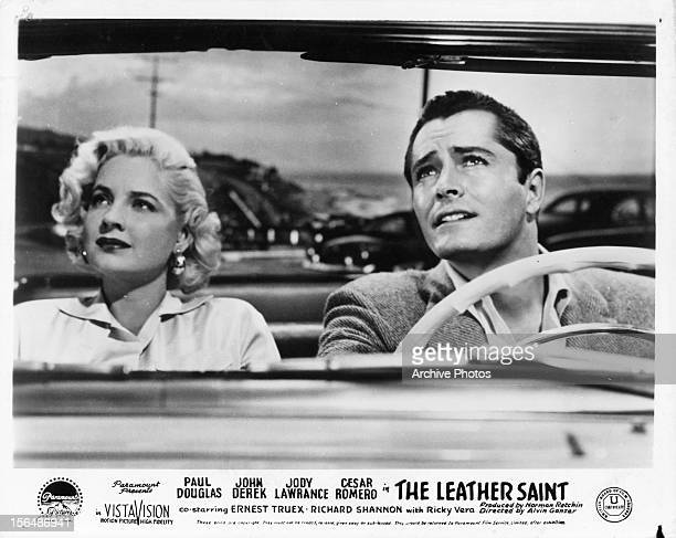 Jody Lawrance and John Derek riding in convertible in a scene from the film 'The Leather Saint' 1956
