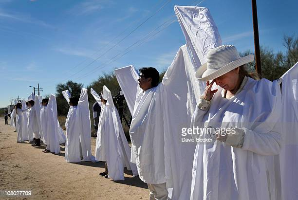 Jody Lee Duek and members of the 'Angel Project' stand along the street leading to the St Elizabeth Ann Seton church for the funeral of nineyearold...