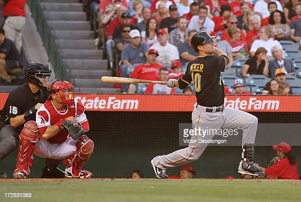 Jody Mercer of the Pittsburgh Pirates hits a tworun homerun to left field in the second inning during the MLB game against the Los Angeles Angels of...