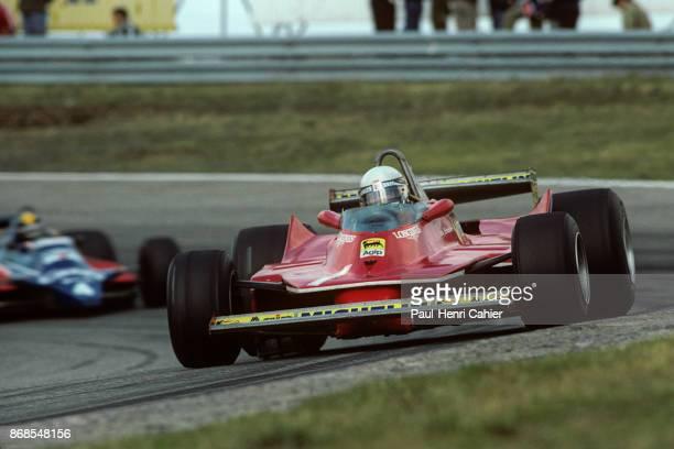 Jody Scheckter Derek Daly Ferrari 312T5 TyrrellFord 010 Grand Prix of the Netherlands Circuit Park Zandvoort 31 August 1980 Zooming into Jody...
