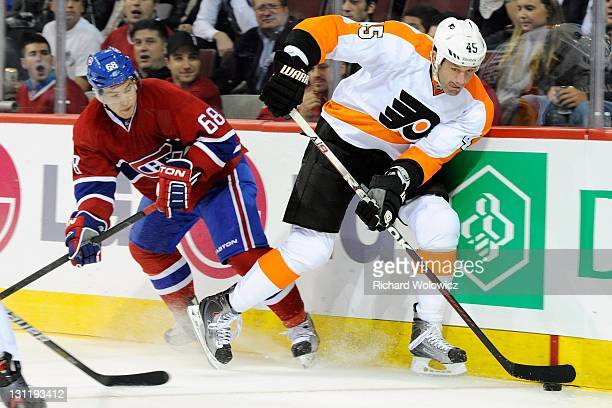 Jody Shelley of the Philadelphia Flyers skates with the puck while being defended by Yannick Weber of the Montreal Canadiens during the NHL game at...