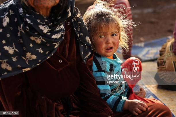 Jody sits with her family who recently arrived from the besieged Syrian city of Aleppo in a makeshift camp in the Bekaa Valley close to the border...