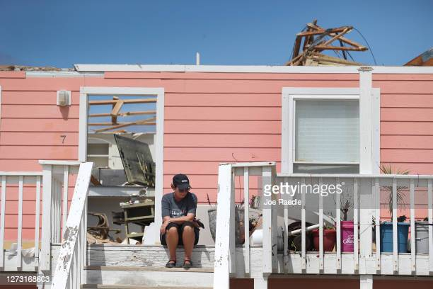 Jody Wright sits on the steps leading to her apartment after the roof was damaged when Hurricane Sally passed through the area on September 17 2020...