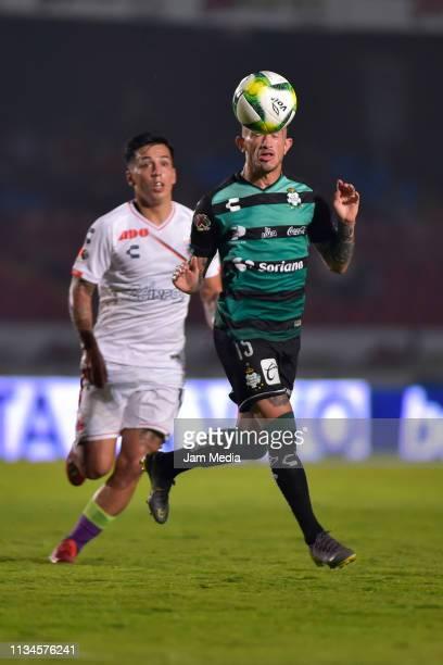 Joe Abrigo of Veracruz fights for the ball with Brian Lozano of Santos during a 10th round match between Veracruz and Santos Laguna as part of Torneo...