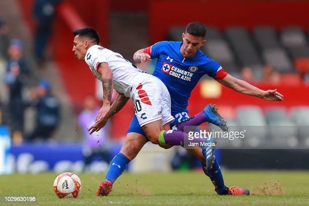 Joe Abrigo of Veracruz fights for the ball with Ivan Marcone of Cruz Azul during the 8th round match between Cruz Azul and Veracruz as part of the...
