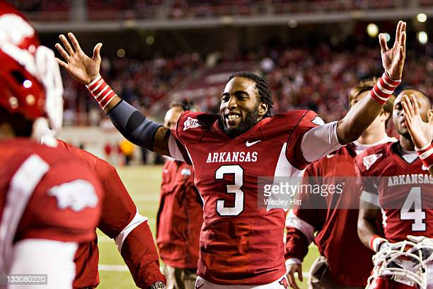 Joe Adams of the Arkansas Razorbacks celebrates with teammates after a touchdown against the Tennessee Volunteers at Donald W. Reynolds Stadium...