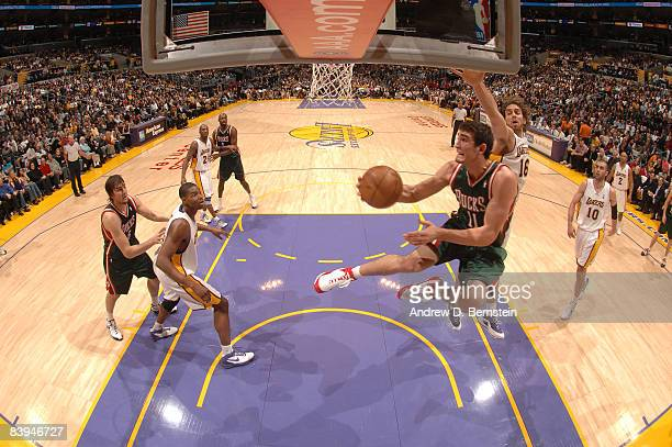 Joe Alexander of the Milwaukee Bucks goes up for a shot against Pau Gasol of the Los Angeles Lakers at Staples Center on December 7 2008 in Los...
