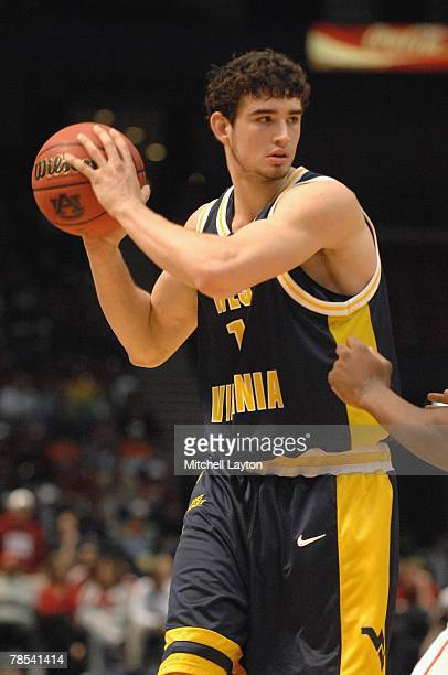 Joe Alexander of the West Virginia Montaineers looks to pass the ball against the Auburn Tigers in the SEC/Big East Invitational at the...