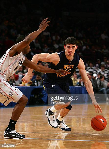 Joe Alexander of the West Virginia Mountaineers drives with the ball against Jerome Dyson of the Connecticut Huskies during day two of the 2008 Big...